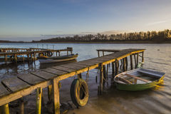 Fishing boats at the pier on the river Royalty Free Stock Image