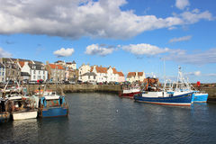 Fishing boats Pittenweem harbour, Fife, Scotland. View from the quayside looking across the harbour to fishing boats docked at Pittenweem in Fife, Scotland with Royalty Free Stock Photo