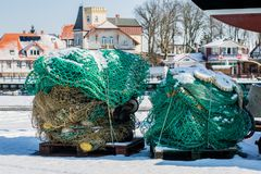 Fishing accessories, nets and ropes on a boat for fishing. Winter season. royalty free stock photography