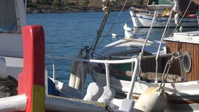 Fishing Boats at the Port. Close up of some fishing boats that are anchored at the port stock video footage