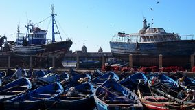 Fishing Boats In Port Essaouira. Fishing boats wait for departure in the sea royalty free stock images