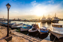 Fishing boats in port of Sozopol at sunset Stock Photography