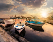Fishing boats in port of Sozopol  at sunset Stock Photo