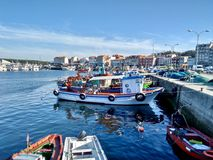 Fishing boats at port during summer in O Grove Spain. On a nice sunny day stock images