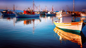 Fishing boats posing. Fishing boats reflected on water Stock Images