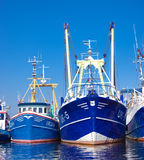 Fishing boats. Prow of some fishing boats in the harbor of Urk, Netherlands. Urk has by far the largest fishing fleet and fish processing industry in the Stock Image