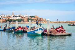 Fishing boats in Rabat, Morocco. With old building at the background Stock Photo
