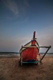 Fishing boats. Red fishing boats on the beach royalty free stock photo