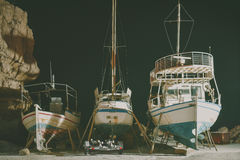 Fishing boats on repair in the port at night Royalty Free Stock Photos