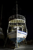 Fishing boats on repair in the port at night Stock Photos