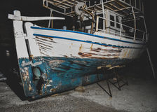 Fishing boats on repair in the port at night Stock Photo