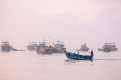 Fishing boats return to port Stock Photos