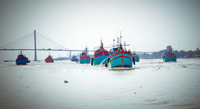 FIshing boats returning from fishing , Mekong Delta, Vietnam. Stock Image