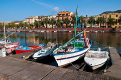 Fishing boats on the river. In Bosa in Sardinia Royalty Free Stock Photo
