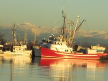 Fishing boats on the river Stock Photo