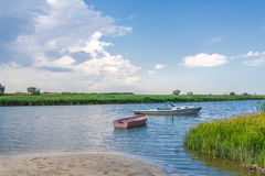 Fishing boats on a river Stock Images