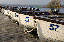 Fishing boats row. Fishing boats at Rutland Water, England Stock Photos