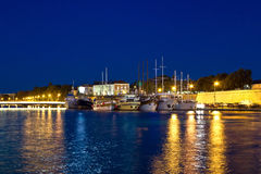 Fishing boats in safe harbor on evening Stock Photography