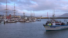 Fishing boats sail out of Fisherman wharf in San Francisco, CA stock video footage