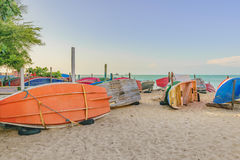 Fishing Boats at Sand in Fortaleza Beach. Group of colored small fishing boats at sand in the beach of Fortaleza, Brazil royalty free stock photos
