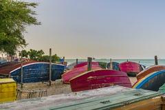 Fishing Boats at Sand in Fortaleza Beach. Group of colored small fishing boats at sand in the beach of Fortaleza, Brazil stock photo