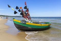 Fishing boats by the sandy beach on the Baltic Sea on a sunny day, Sopot, Poland.  Royalty Free Stock Image