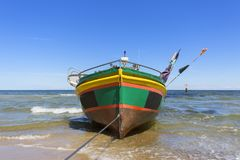Fishing boats by the sandy beach on the Baltic Sea on a sunny day, Sopot, Poland.  royalty free stock photos