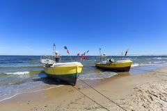 Fishing boats by the sandy beach on the Baltic Sea on a sunny day, Sopot, Poland,. Fishing boat by the sandy beach on the Baltic Sea on a sunny day, Sopot royalty free stock image