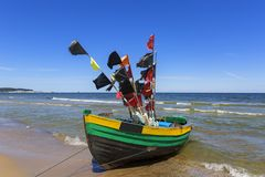 Fishing boats by the sandy beach on the Baltic Sea on a sunny day, Sopot, Poland.  royalty free stock photography
