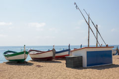 Fishing boats on a sandy beach in Spain Stock Photos