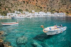 Fishing boats and the scenic village of Loutro in Crete Greece. Fishing boats and the scenic village of Loutro in Crete, Greece Royalty Free Stock Photography