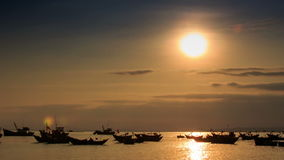 Fishing Boats in Sea Bay at Sunset in Vietnam under Sunpath. View of vietnamese fishing boats floating in calm sea bay at sunset under sunpath stock video footage