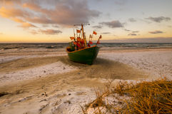 Fishing boats on the sea beach during sunset Royalty Free Stock Photos