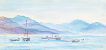 Fishing boats. In sea. In distances high mountains Stock Photo
