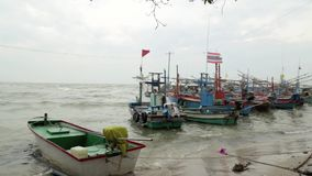 Fishing boats, sea fish,. Shallow water of fishermen in Thailand stock video footage
