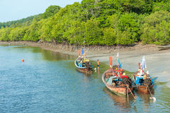 Fishing boats in sea and mangrove forest of Thailand Stock Images