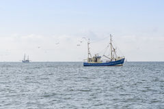 Fishing boats on a sea Stock Image