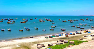 Fishing boats on the sea in Phan Thiet, Vietnam. Traditionally, fishing and manufacturing of fish sauce has been the main source of Phan Thiet's income stock photography