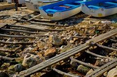 Fishing boats at sea shore royalty free stock photography