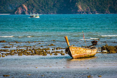 Fishing boats on the sea shore in Thailand Stock Photography