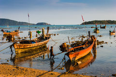 Fishing boats on the sea shore in Thailand Stock Image