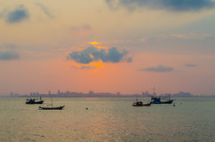 Fishing boats at sea. At sunrise Hua Hin Thailand Royalty Free Stock Images