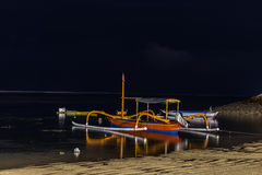 Fishing boats on the sea of tropical island Bali at night, Indonesia. Stock Photography