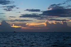 Fishing boats at sea at twilight Stock Photo