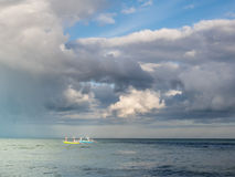 Fishing boats in the sea under the clouds. Stock Photos