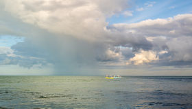 Fishing boats in the sea under the clouds. Royalty Free Stock Photos