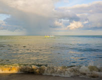Fishing boats in the sea under the clouds. Fishing boats in the sea Royalty Free Stock Images
