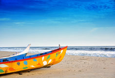 Fishing boats on seashore. On a sunny day. Kerala Andhakaranazhi Beach, Kochi Royalty Free Stock Photo