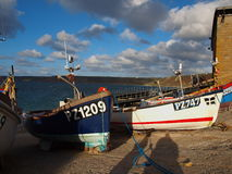 Fishing Boats Sennen Cove Cornwall. Small fishing boats on the slipway near the lifeboat house in Sennen Cove Cornwall Stock Photo