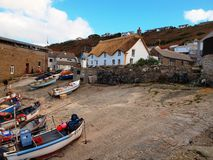 Fishing Boats Sennen Cove Cornwall. Small fishing boats on the slipway near the lifeboat house in Sennen Cove Cornwall Stock Image
